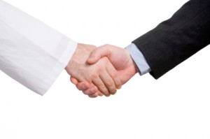 Business and medicine handshake