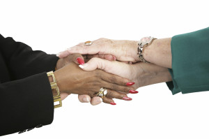 Female Business Team Holding Hands